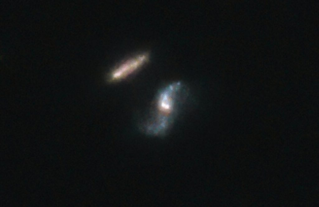 The Hubble Space Telescope image of interacting galaxies: the host galaxy of GRB 190114C (blue) and the companion galaxy (red), credit: A. de Ugarte Postigo and A. J. Levan, NASA, ESA